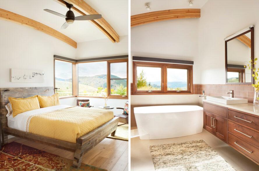 A gauche, grand lit avec literie jaune.  À droite, salle de bain avec baignoire autoportante.