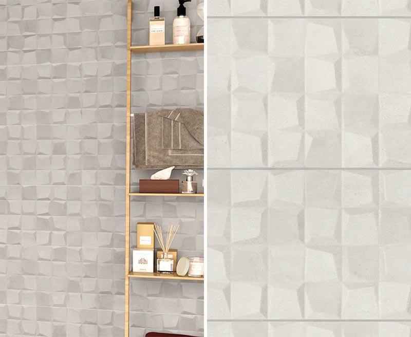 Un carrelage mural de salle de bain tridimensionnel en beige.