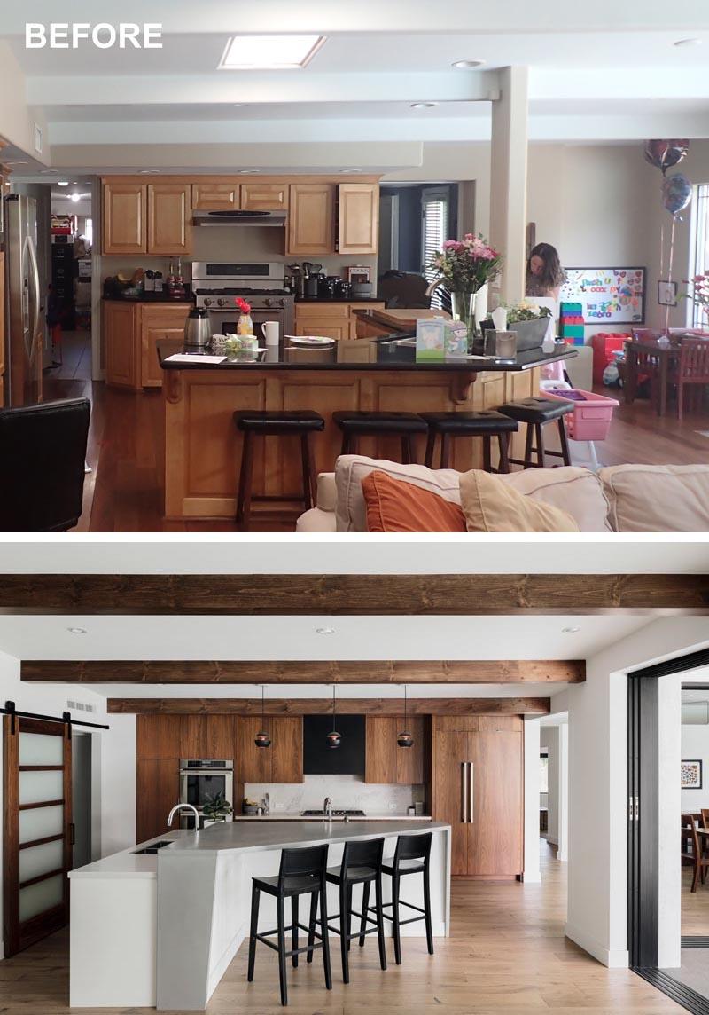 Une cuisine rénovée a maintenant un plus grand îlot de cuisine avec des sièges.
