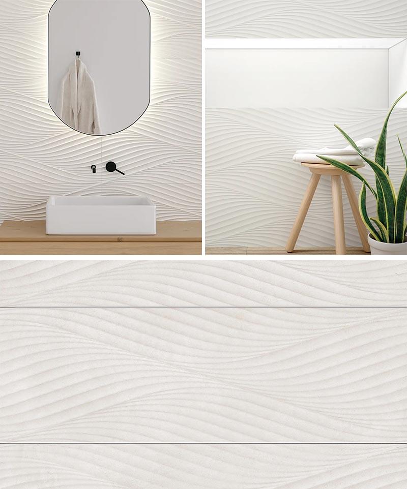 Un carrelage mural de salle de bain blanc moderne qui a une texture ondulée.
